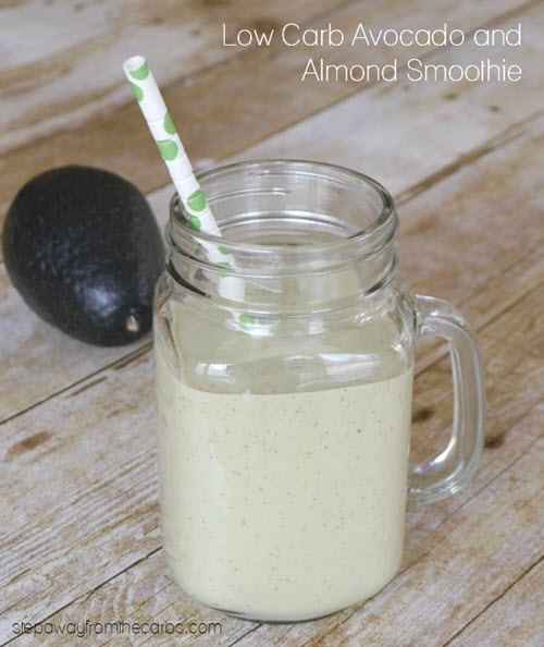 A light green shake in a mason jar with avocado and a straw