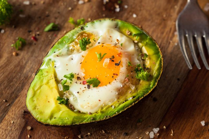 A baked avocado with an egg
