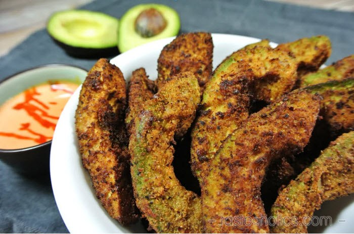 A plate of sliced avocado that has been coated and fried.