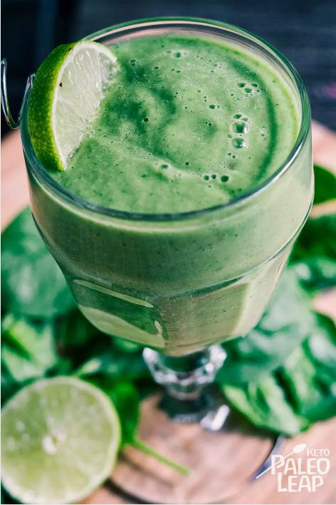 Green smoothie in a glass with lime