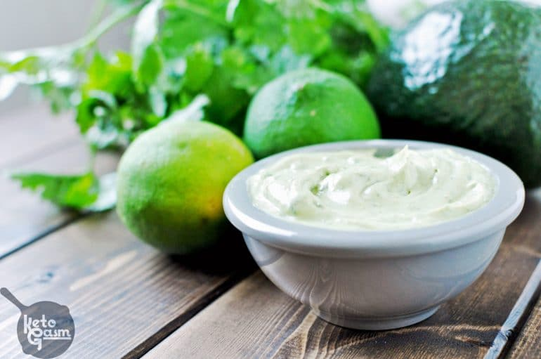 Mayonnaise on a wooden board with lime and cilantro