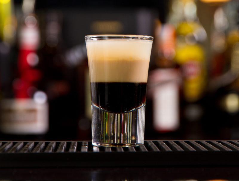A layered B52 shot in a glass on a bar