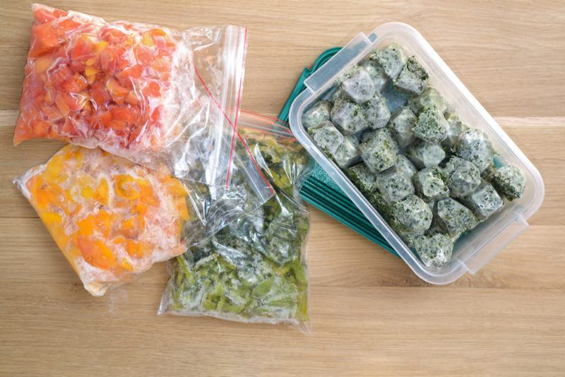 Bags and a container of frozen veggies