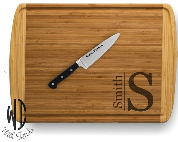 Two-tone cutting board with a monogram and surname.