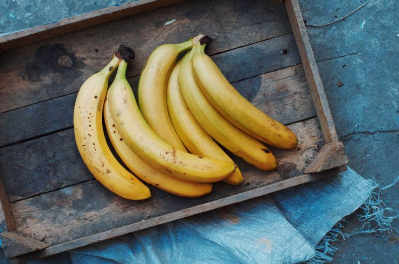 Ripe bananas on a wooden tray