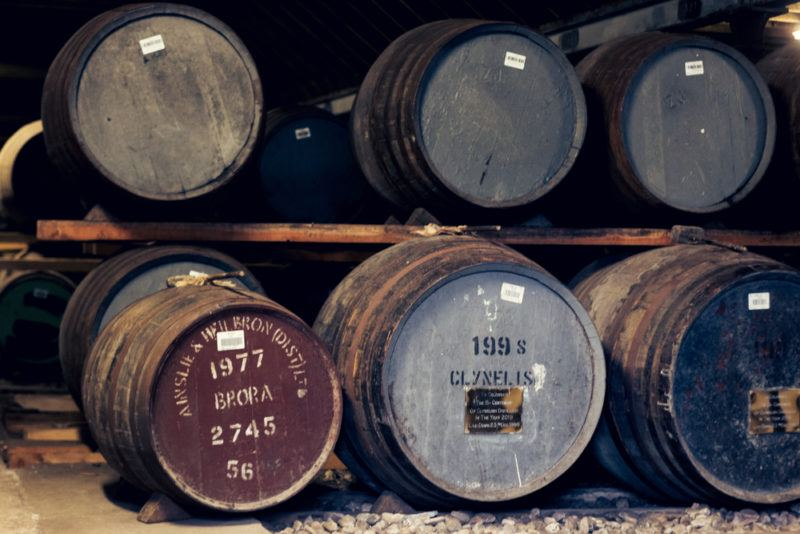 Barrels of whiskey aging, including Brora whiskey