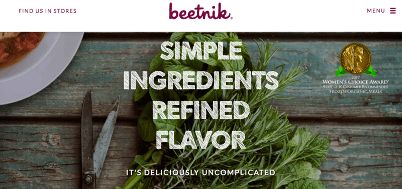 Beetnik website screenshot showing greens on a table, along with the phrase 'Simple Ingredients Refined Flavor'