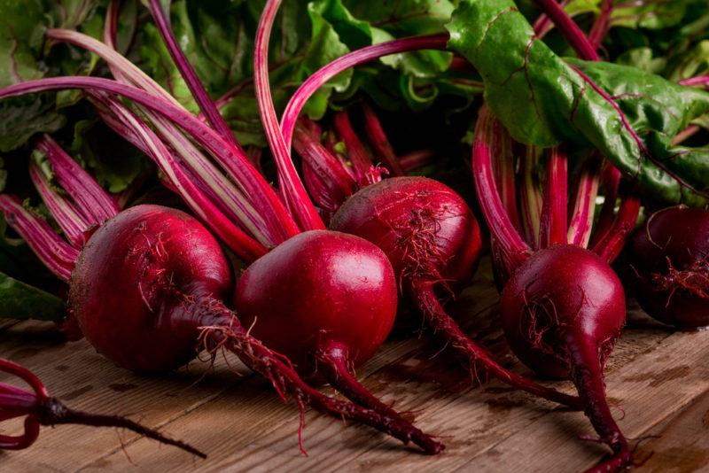 Red beetroot with stems and leaves
