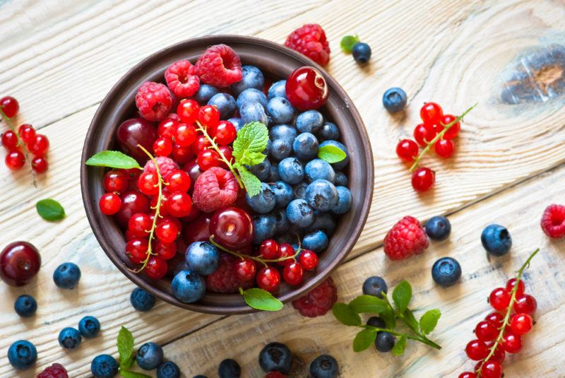 A bowl containin a variety of fresh summer berries
