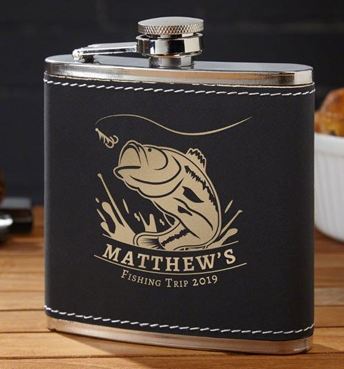 Black leather flask with a copper fish and text.