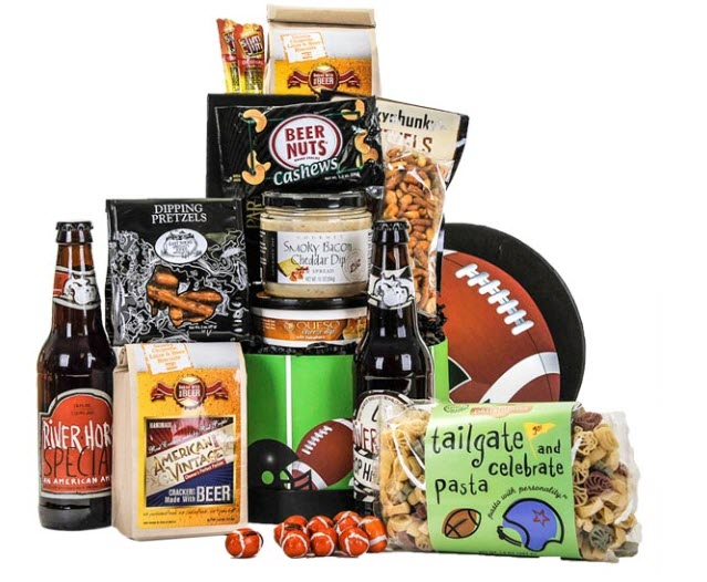 A pyramid of items including various football-themed snacks and two bottles of beer.