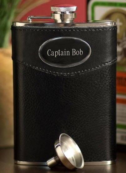 An entirely black flask with the words Captain Bob engraved into it.