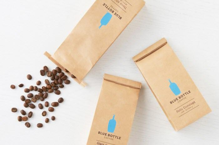 3 bags of coffee beans, with one open and spilling