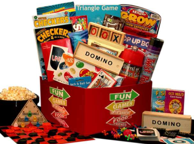 Red Open top box with overflowing with games with games sitting around the base of the box and a bowl of popcorn on the left