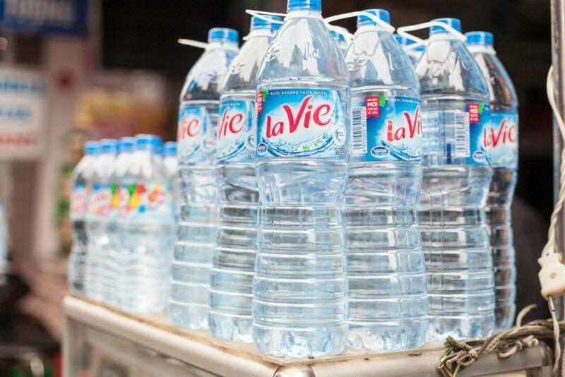 Large and small bottles of filtered water in a Vietnamese grocery store