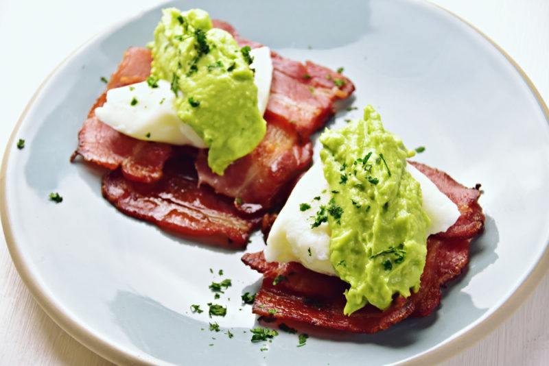 A breakfast hash using bacon, egg, and avocado