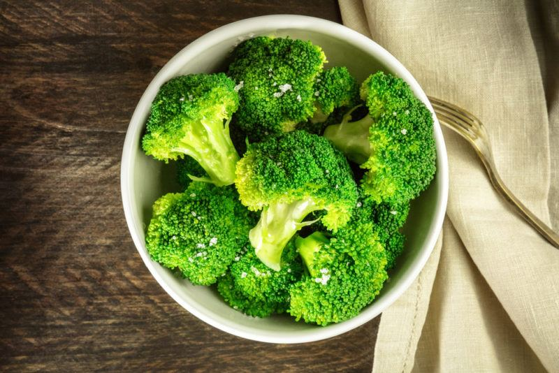 A white bowl containing broccoli