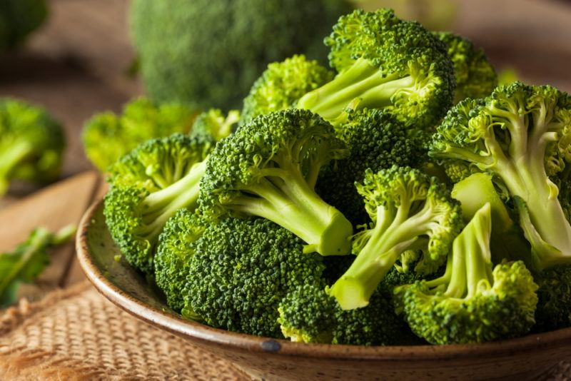 A dish containing cooked broccoli heads