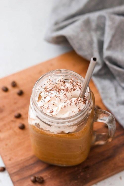 A mocha shake in a mason jar glass