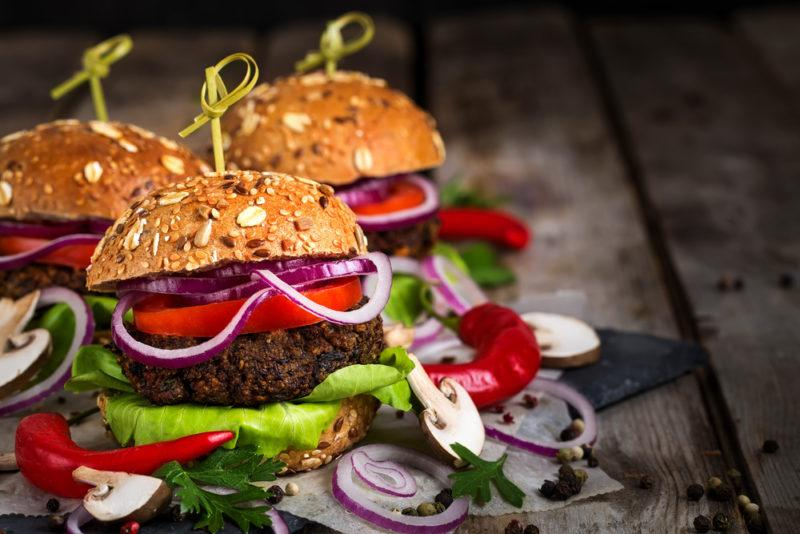 Three burgers that have been made using mushroom patties