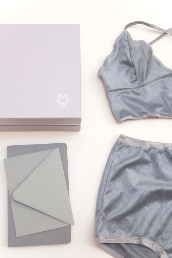 Burgundy Fox Subscription showing a box, envelope, bra, and panties
