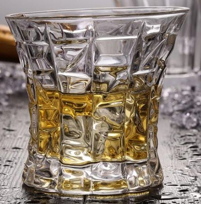 A whiskey glass with various squares