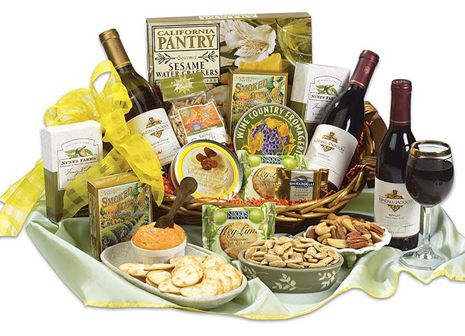 Basket with wine and a collection of different snacks.