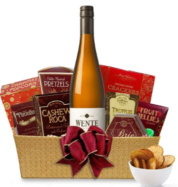 Basket with a bottle of wine and a small selection of snacks