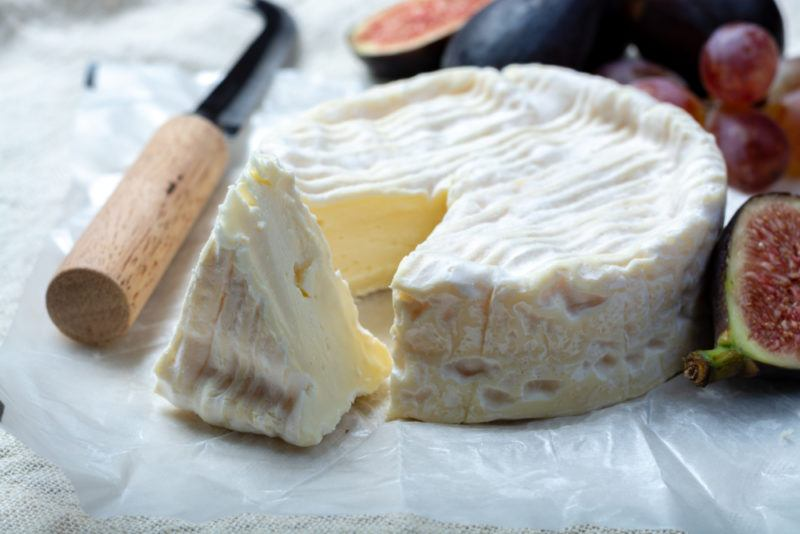 Camebert Cheese on a white plate with figs
