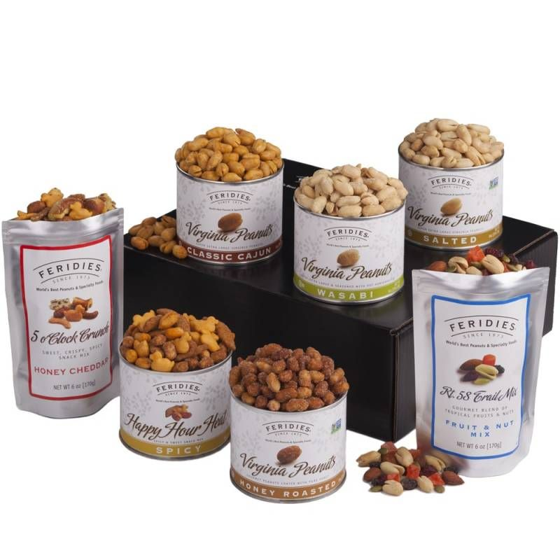 Variety of open canisters and bags of different peanut flavors like - Honey cheddar, spicy, honey roasted, classic Cajun, wasabi, Salted three canisters are sitting on a black box