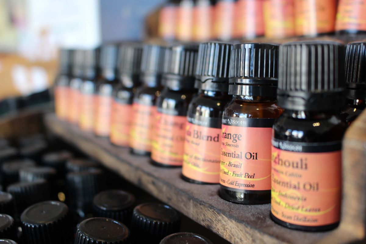 Essential Oil of the Month Club - Several bottle of essential oils sitting on wooden shelves