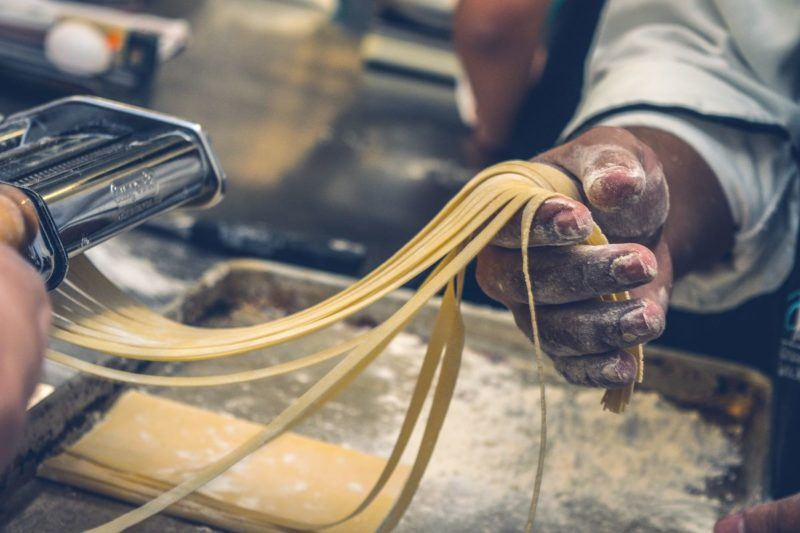 Fresh handmade pasta being made in a commercial kitchen