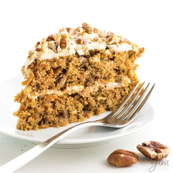A carrot cake with a fork on a white plate