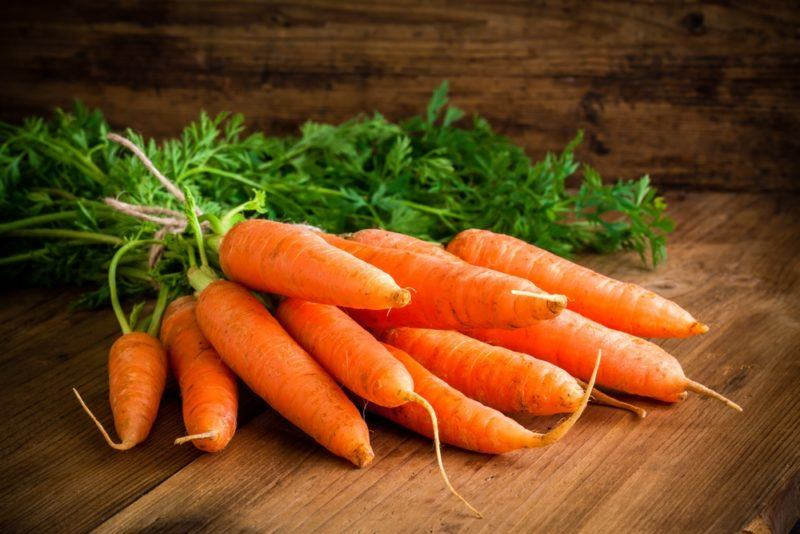 Fresh carrots on a wooden floor