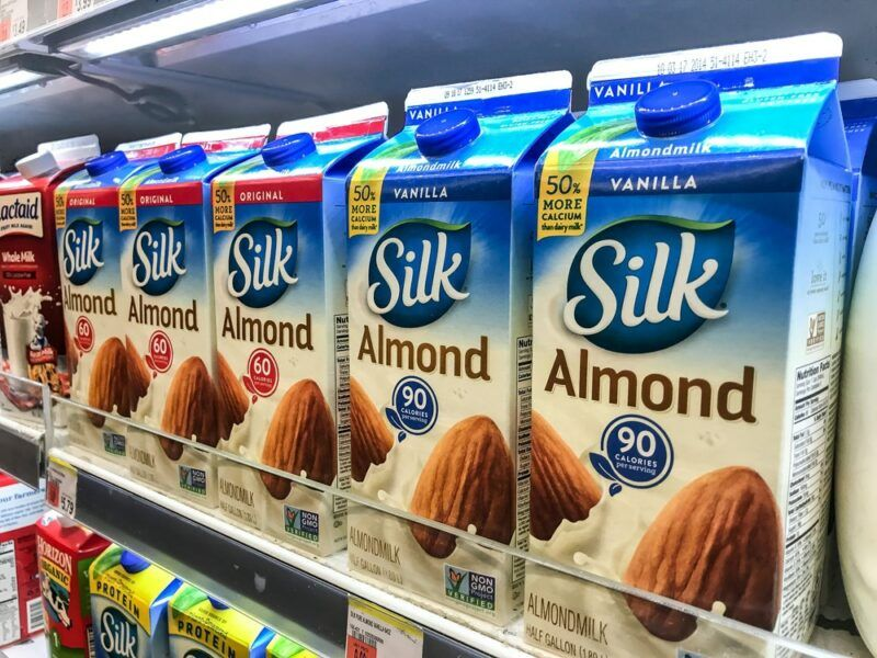 Boxes of Silk almond milk on a grocery store shelf