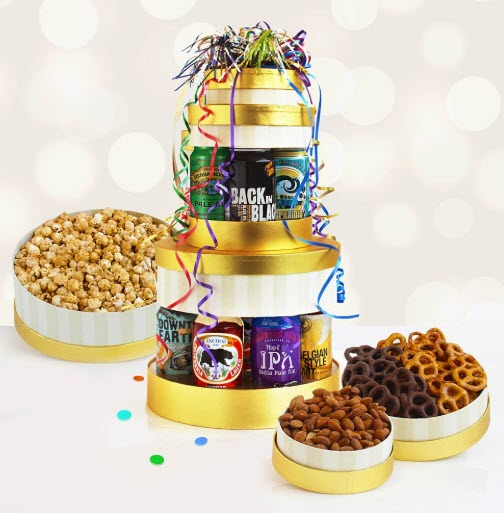 A stack of golden and white boxes with beer cans between them. Open boxes next to the stack show popcorn, pretzels and almonds.