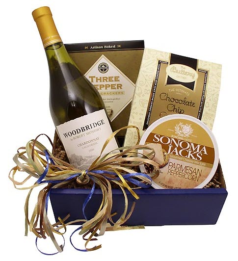 A blue box containing a bottle of wine, crackers, cookies and cheese