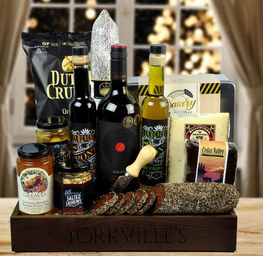 Wooden box containing wine, sausage, cheese and more