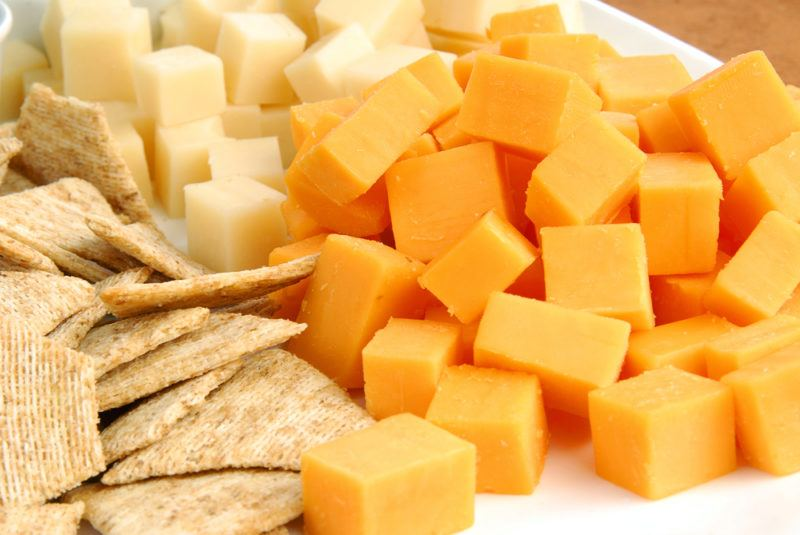 Cubes of two types of cheese and some crackers