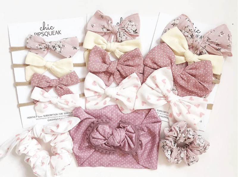 Chic Pipsqueak bows in various styles, with a focus on pink, white and yellow bows