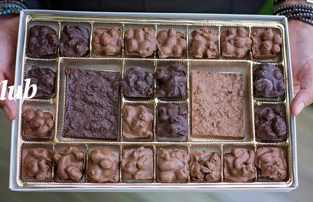 A tray with various hand dipped chocolates