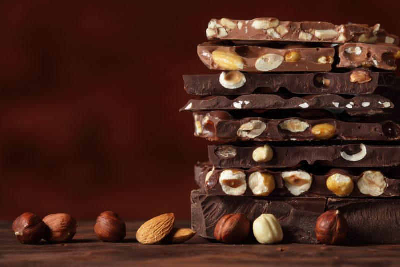 A stack of chocolate pieces with nuts embedded in them