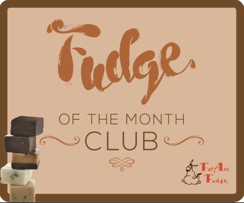 Light brown background with tan writing that states Fudge, of the Month Club.  In the lower right corner it says Fat Ass Fudge in the left lower corner is a stack of small square pieces of fudge of varying colors.