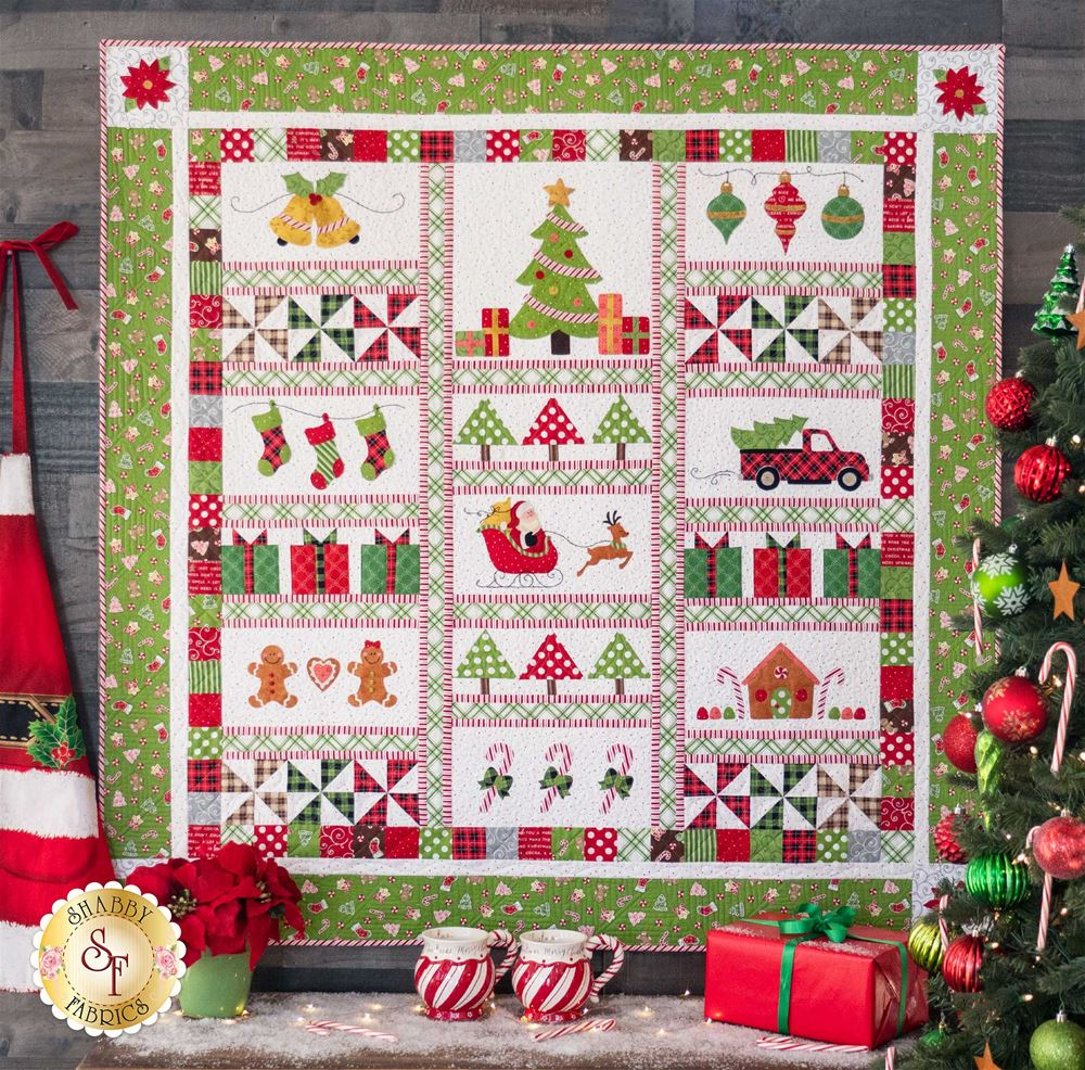 Christmas quilt with christmas decorations around and in the background