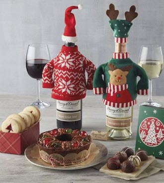 Two bottles of wine in sweaters with snacks