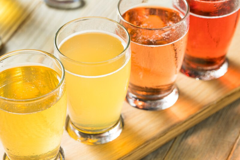 Hard cider of the month club.  A flight of 4 ciders on a wooden plank
