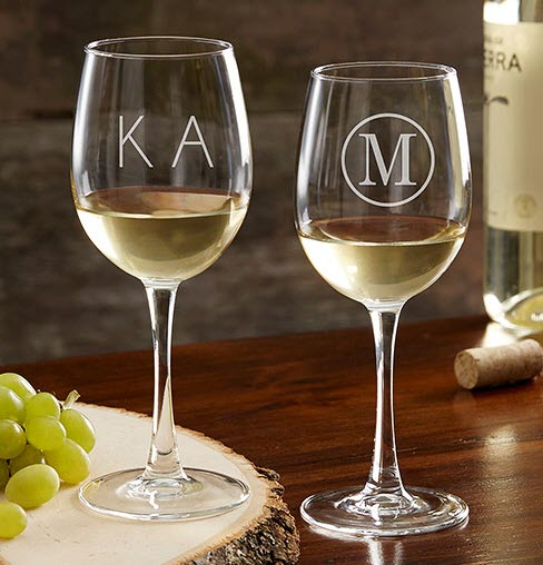 Two white wine glasses, with different monograms