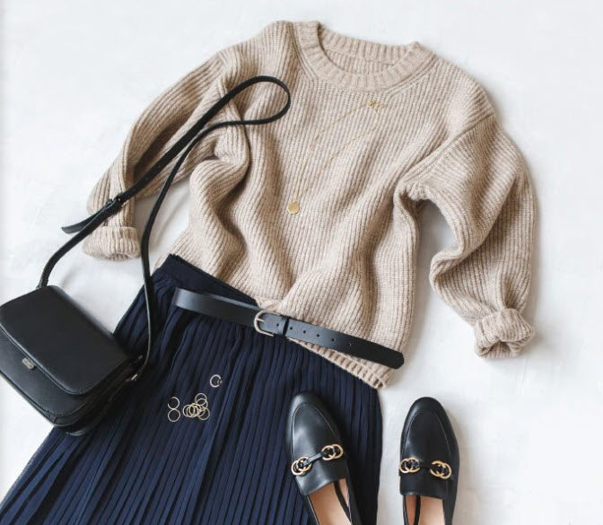 A selection of pieces from a Stylogic box, including shoes, a handbag, a top and a shirt