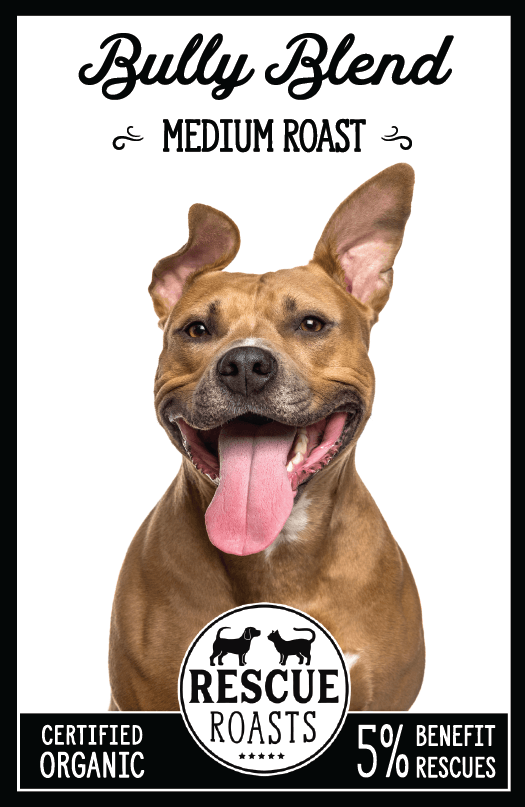 "White background, black whimsical font that says, ""Bully Blend Medium Roast"" On the bottom it says certified organic, rescue roasts, 5% benefit rescues.  The main photo is a happy smiling brown dog looking into the camera, the right ear is up and the left is half bent"
