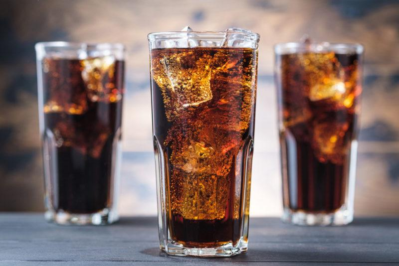 Three glasses of cola and ice